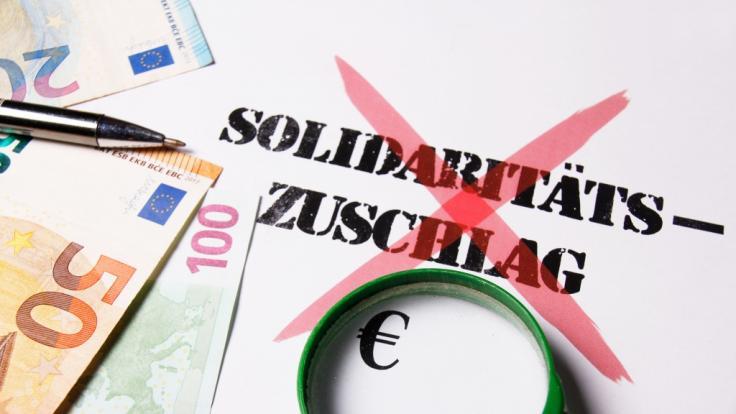Der Soli soll bereits zum 1. Juli abgeschafft werden.