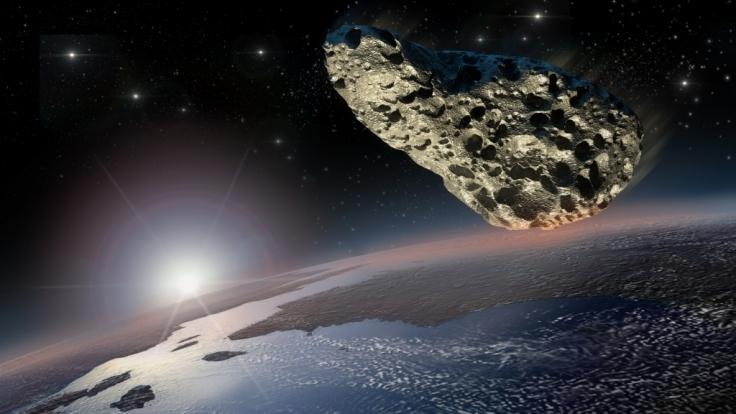 Ein Asteroid nimmt Kurs auf die Erde. (Symbolbild)