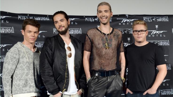 """Georg Listing, Tom und Bill Kaulitz und Gustav Schäfer zur Veröffentlichung ihres Albums """"Kings of Suburbia"""" 2014. (Foto)"""
