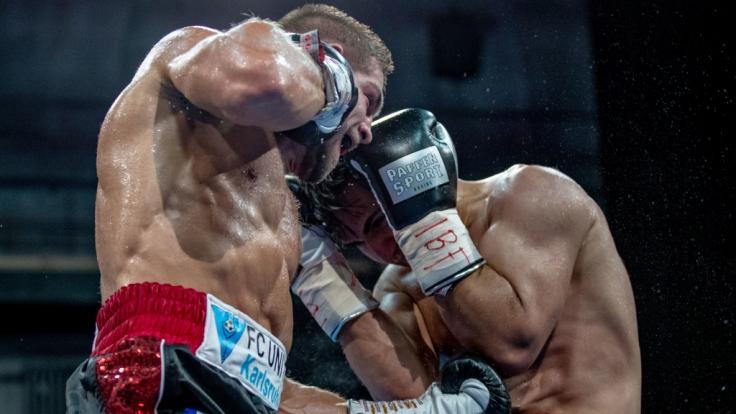 Körpertreffer von Fincent Feigenbutz mit linkem Aufwärtshaken gegenJama Saidi (Foto)
