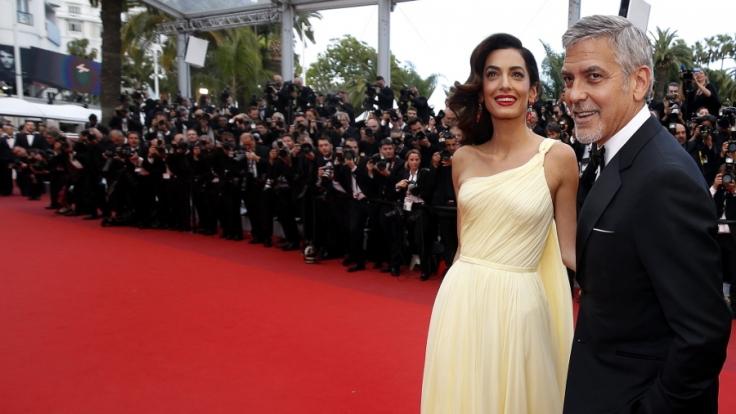 Der Hollywood-Schauspieler George Clooney mit seiner Frau, der Anwältin Amal Alamuddin Clooney.