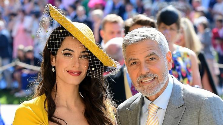 Amal und George Clooney bei Meghans und Harrys Hochzeit.