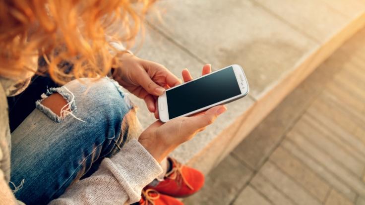 In einem Jahr nahm die Zahl der Handy-süchtigen um 60 Prozent zu.