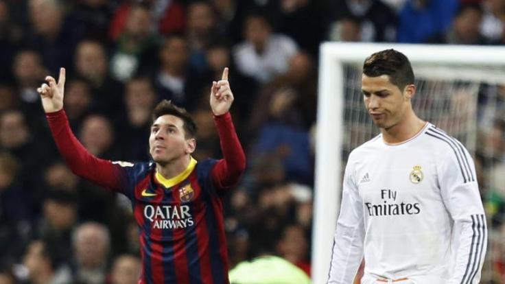 Das ewige Duell der besten Fußballer: Lionel Messi (li.) gegen Cristiano Ronaldo (re.).