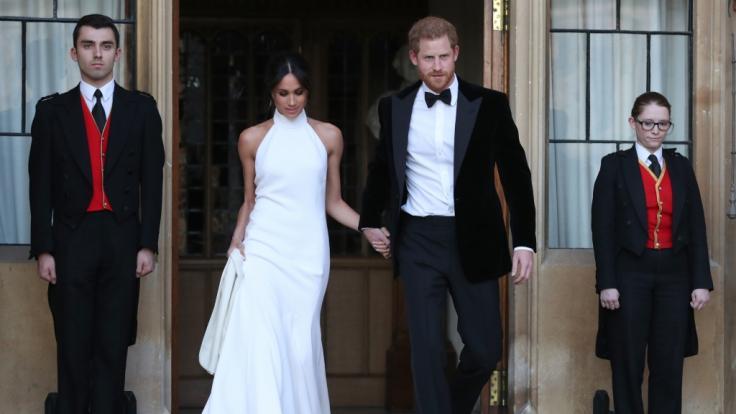 Prinz Harry und seine Frau Meghan verlassen das Windsor Castle.