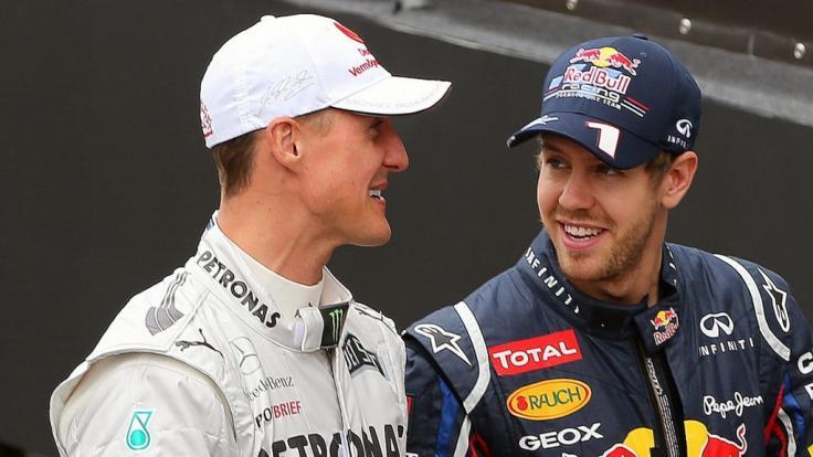Immer wieder wird Sebastian Vettel (r.) mit Michael Schumacher verglichen. (Foto)